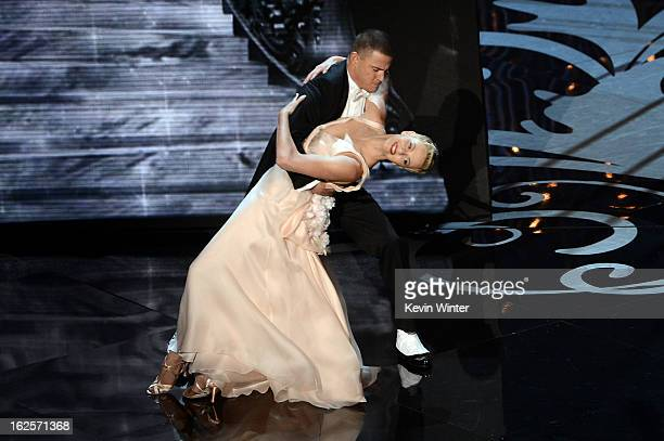 Actor Channing Tatum and actress Charlize Theron dance onstage during the Oscars held at the Dolby Theatre on February 24 2013 in Hollywood California