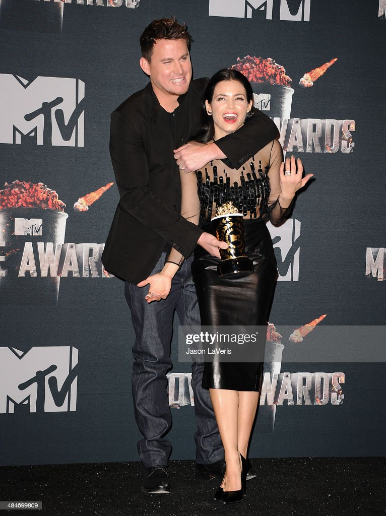 Actor <a gi-track='captionPersonalityLinkClicked' href=/galleries/search?phrase=Channing+Tatum&family=editorial&specificpeople=549548 ng-click='$event.stopPropagation()'>Channing Tatum</a> and actress Jenna Dewan Tatum pose in the press room at the 2014 MTV Movie Awards at Nokia Theatre L.A. Live on April 13, 2014 in Los Angeles, California.