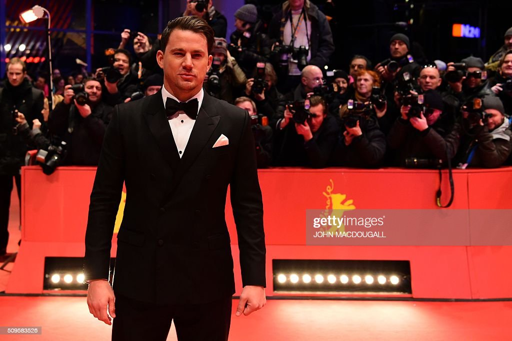 US actor Channing Tatum poses for photographers as he arrives on the red carpet for the film 'Hail, Caesar!' screening as opening film of the 66th Berlinale Film Festival in Berlin on February 11, 2016. Eighteen pictures will vie for the Golden Bear top prize at the event which runs from February 11 to 21, 2016. / AFP / John MACDOUGALL