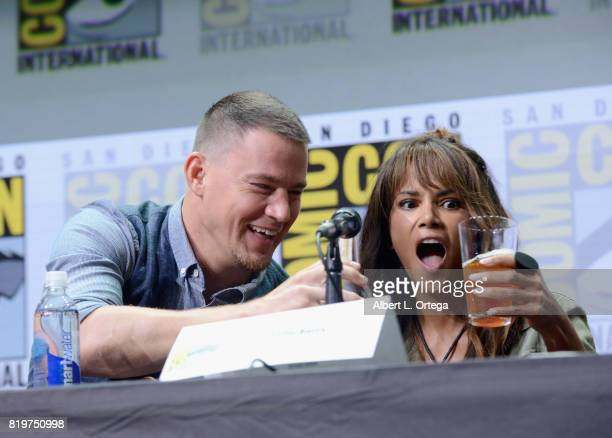 Actor Channing Tatum pours actor Halle Berry a drink onstage at the 20th Century FOX panel during ComicCon International 2017 at San Diego Convention...