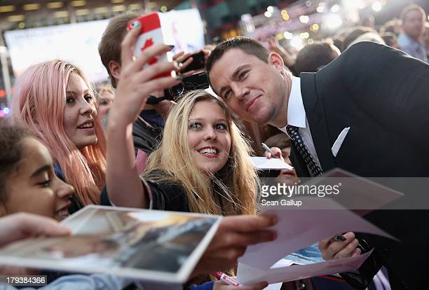 Actor Channing Tatum signs autographs for fans as he attends the 'White House Down' Germany premiere at CineStar on September 2 2013 in Berlin Germany