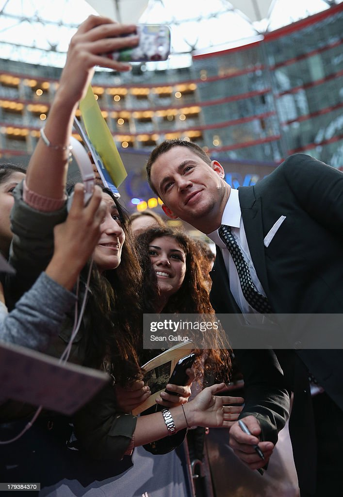 Actor <a gi-track='captionPersonalityLinkClicked' href=/galleries/search?phrase=Channing+Tatum&family=editorial&specificpeople=549548 ng-click='$event.stopPropagation()'>Channing Tatum</a> signs autographs for fans as he attends the 'White House Down' Germany premiere at CineStar on September 2, 2013 in Berlin, Germany.
