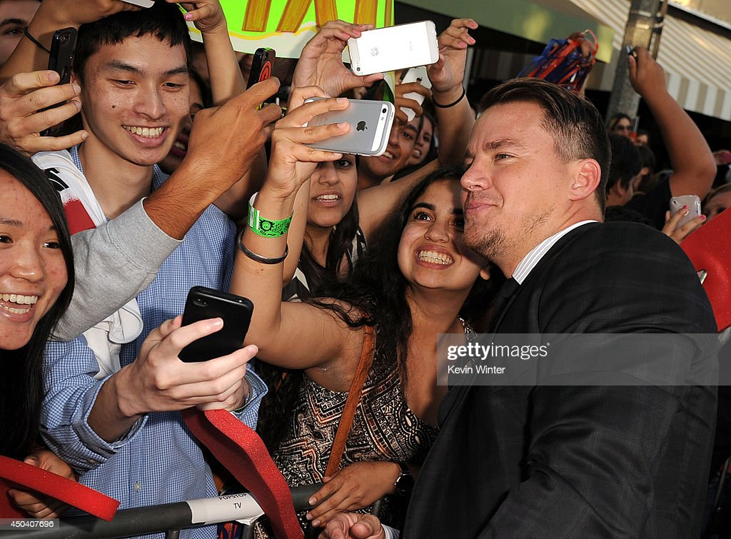 Actor <a gi-track='captionPersonalityLinkClicked' href=/galleries/search?phrase=Channing+Tatum&family=editorial&specificpeople=549548 ng-click='$event.stopPropagation()'>Channing Tatum</a> takes a selfie with fans during the Premiere Of Columbia Pictures' '22 Jump Street' at Regency Village Theatre on June 10, 2014 in Westwood, California.