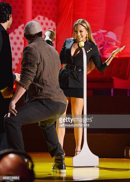 Actor Channing Tatum twerks as actress/singer Jennifer Lopez accepts her award onstage during The 2015 MTV Movie Awards at Nokia Theatre LA Live on...