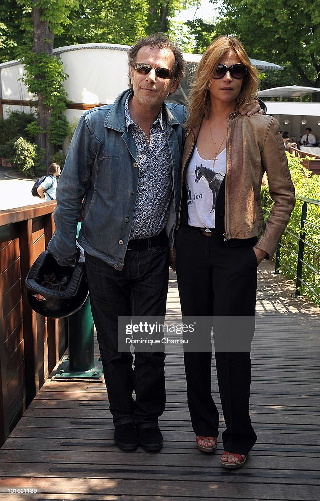 Actor Charles Berling and his girl friend Virginie Leclerc sighting at the French Open on June 4 2010 in Paris France