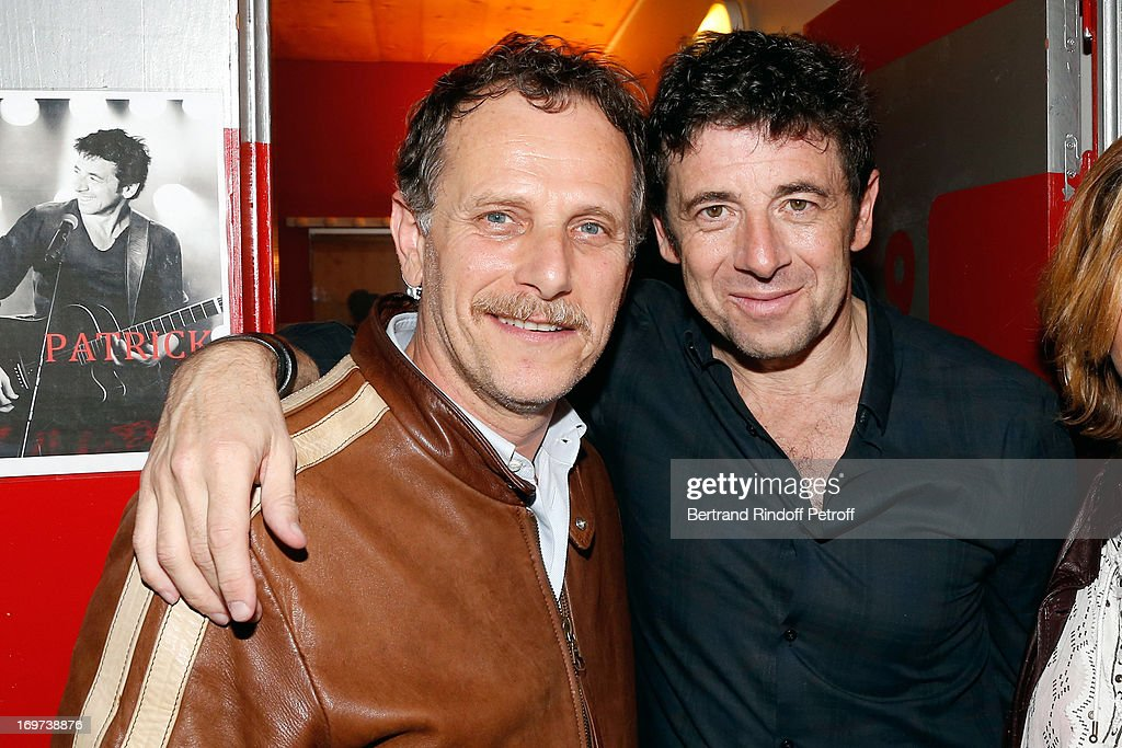 Actor Charles Berling and Singer Patrick Bruel backstage after Patrick Bruel's concert at Zenith de Paris on May 30 2013 in Paris France