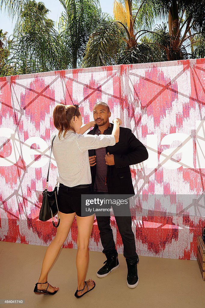 Actor Charles Michael Davis and dancer Katrina Amato attend the HBO Luxury Lounge featuring PANDORA at Four Seasons Hotel Los Angeles at Beverly Hills on August 23, 2014 in Beverly Hills, California.