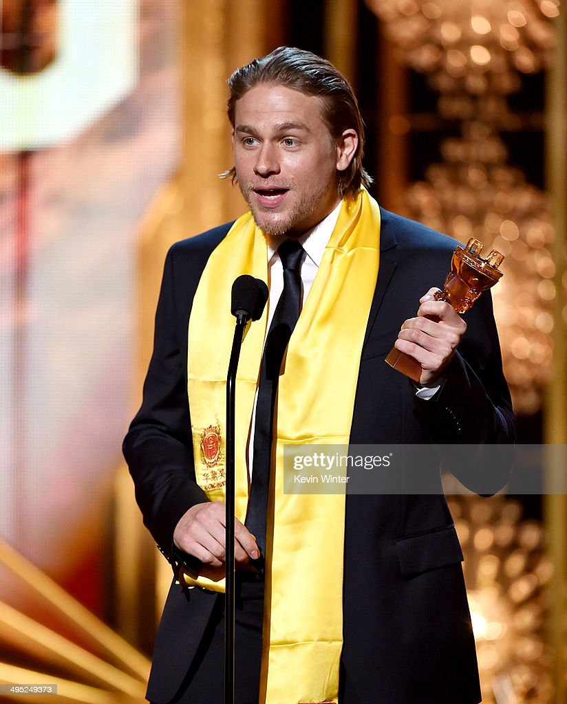 Actor <a gi-track='captionPersonalityLinkClicked' href=/galleries/search?phrase=Charlie+Hunnam&family=editorial&specificpeople=223913 ng-click='$event.stopPropagation()'>Charlie Hunnam</a> accepts the Global Emerging Actor Award at the 2014 Huading Film Awards at The Montalban Theatre on June 1, 2014 in Los Angeles, California.