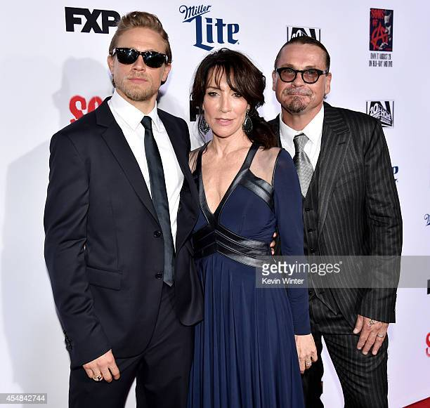 Actor Charlie Hunnam actress Katey Sagal and executive producer/creator Kurt Sutter arrive at the season 7 premiere screening of FX's 'Sons of...