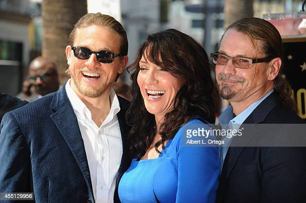 Actor Charlie Hunnam actress Katey Sagal and husband Kurt Sutter at Katey Sagal's Star Ceremony on the Hollywood Walk Of Fame on September 9 2014 in...