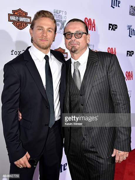 Actor Charlie Hunnam and executive producer/creator Kurt Sutter arrive at the season 7 premiere screening of FX's 'Sons of Anarchy' at the Chinese...