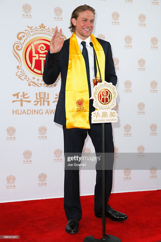 Actor <a gi-track='captionPersonalityLinkClicked' href=/galleries/search?phrase=Charlie+Hunnam&family=editorial&specificpeople=223913 ng-click='$event.stopPropagation()'>Charlie Hunnam</a> poses with the award for Best Global Emerging Actor in the press room during the Huading Film Awards on June 1, 2014 at Ricardo Montalban Theatre in Los Angeles, California. Huading Film Awards is China's #1 Film awards, in the U.S. for the first time.