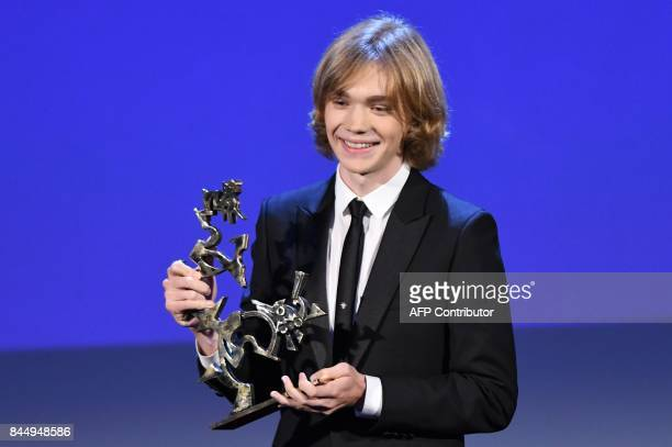 Actor Charlie Plummer receives the Marcello Mastroianni Award for Best New Young Actor for his character in the movie 'Lean on Pete' during the award...