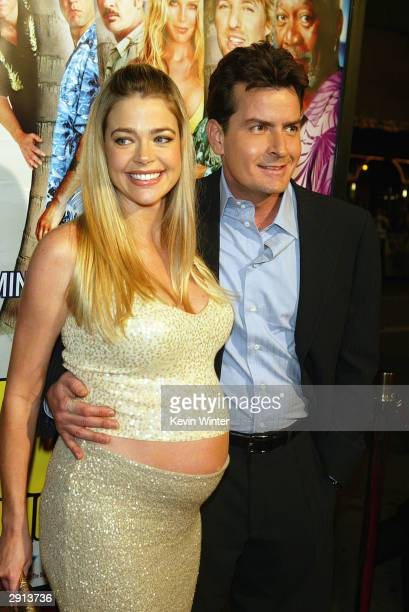 Actor Charlie Sheen and his wife Denise Richards arrive at the Los Angeles premiere of Warner Bros 'The Big Bounce' at the Mann's Village on January...