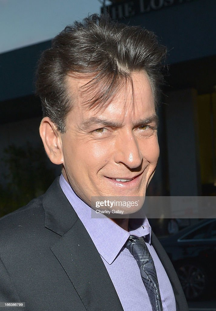 Actor <a gi-track='captionPersonalityLinkClicked' href=/galleries/search?phrase=Charlie+Sheen&family=editorial&specificpeople=206152 ng-click='$event.stopPropagation()'>Charlie Sheen</a> arrives at the premiere of 'Scary Movie V' presented by Dimension Films, in partnership with Lexus and Chambord at the Cinerama Dome on April 11, 2013 in Los Angeles, California.