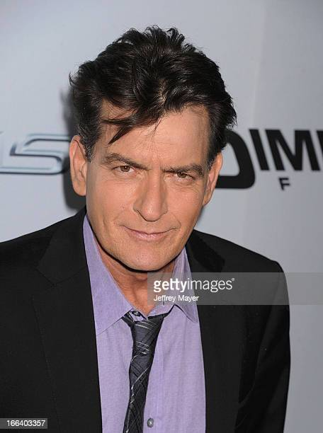 Actor Charlie Sheen arrives at the 'Scary Movie V' Los Angeles premiere atArcLight Cinemas Cinerama Dome on April 11 2013 in Hollywood California