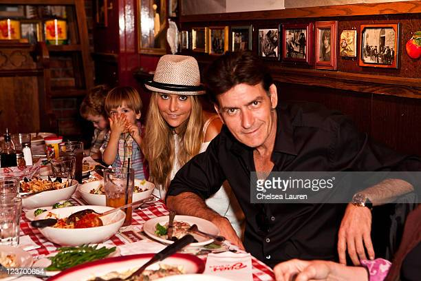 Actor Charlie Sheen Brooke Mueller sons Max Sheen and son Bob Sheen celebrate Charlie Sheen's his birthday with family at Buca di Beppo on September...