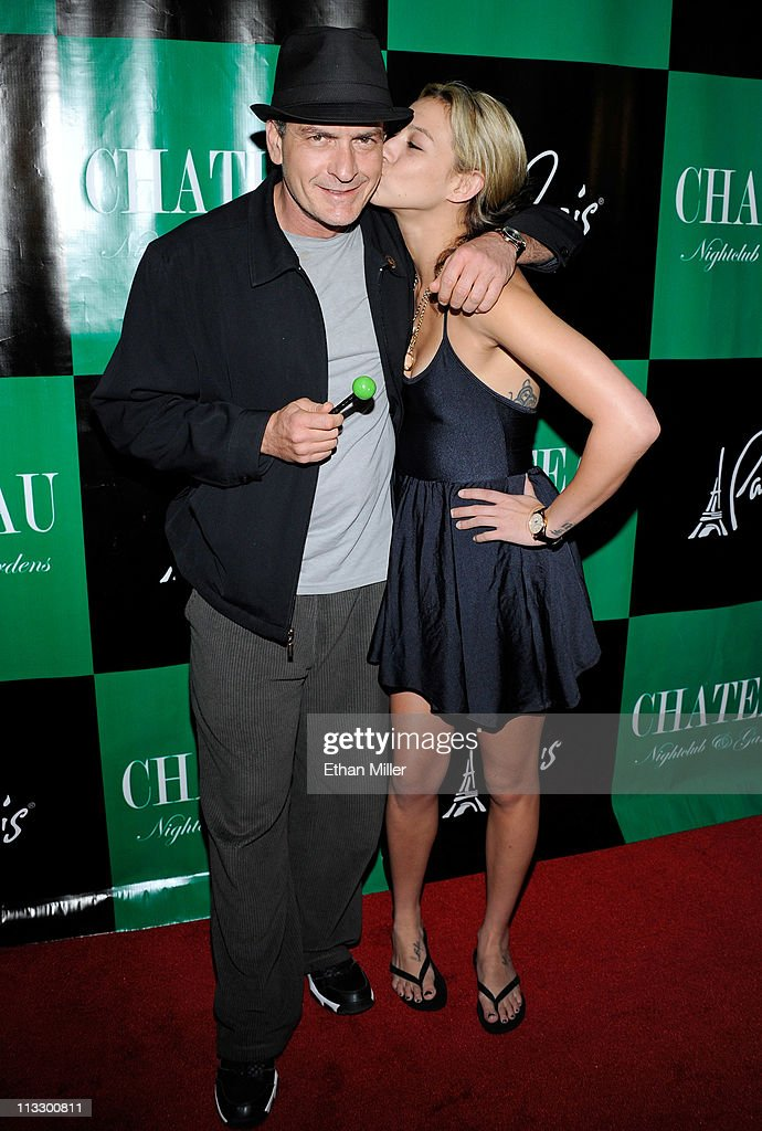 Actor <a gi-track='captionPersonalityLinkClicked' href=/galleries/search?phrase=Charlie+Sheen&family=editorial&specificpeople=206152 ng-click='$event.stopPropagation()'>Charlie Sheen</a> (L) is kissed by Natalie Kenley as they arrive at the Chateau Nightclub & Gardens at the Paris Las Vegas early May 1, 2011 in Las Vegas, Nevada.