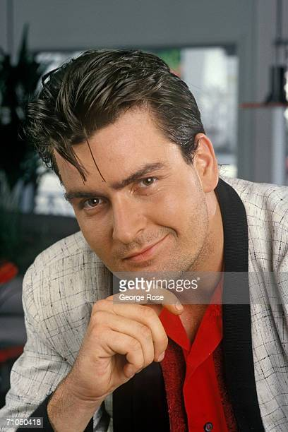 Actor Charlie Sheen poses during a 1990 Malibu California portrait session Sheen star of such TV hits as 'Spin City' and 'Two and a Half Men' also...