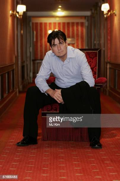 Actor Charlie Sheen poses for a portrait session at the Majestic hotel during the 59th International Cannes Film Festival on May 20 2006 in Cannes...