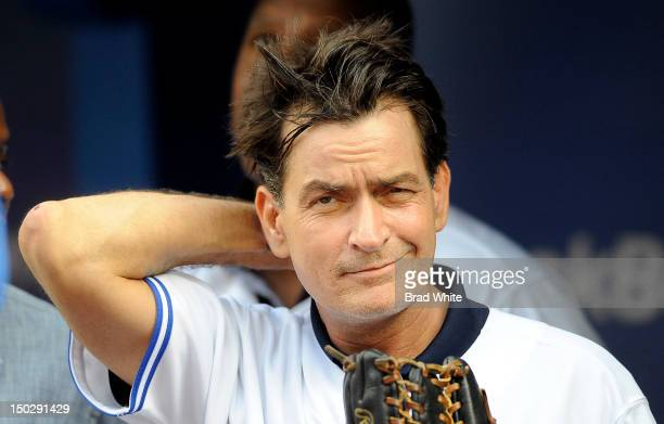 Actor Charlie Sheen throws out the ceremonial first pitch prior to MLB game action between the Toronto Blue Jays and Chicago White Sox August 14 2012...