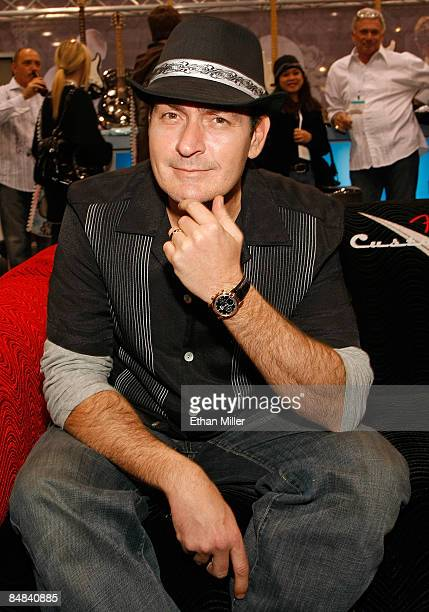 Actor Charlie Sheen wears a shirt from his new DaVinci Collection by Charlie Sheen line at the Defiance USA booth at the MAGIC convention at the Las...