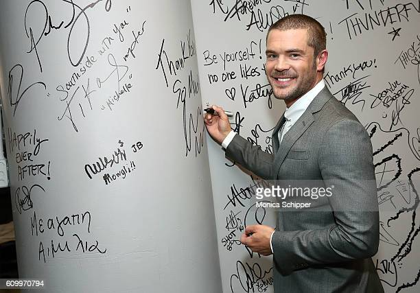 Actor Charlie Weber signs the wall at AOL HQ when he visits for The Build Series Presents Charlie Weber Discussing The Show 'How To Get Away With...