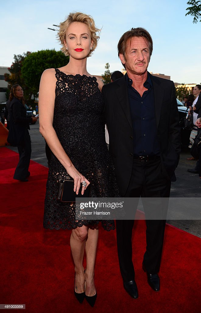 Actor <a gi-track='captionPersonalityLinkClicked' href=/galleries/search?phrase=Charlize+Theron&family=editorial&specificpeople=171250 ng-click='$event.stopPropagation()'>Charlize Theron</a> and <a gi-track='captionPersonalityLinkClicked' href=/galleries/search?phrase=Sean+Penn&family=editorial&specificpeople=202979 ng-click='$event.stopPropagation()'>Sean Penn</a> attend the premiere of Universal Pictures and MRC's 'A Million Ways To Die In The West' at Regency Village Theatre on May 15, 2014 in Westwood, California.