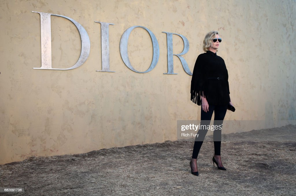 Actor Charlize Theron attends the Christian Dior Cruise 2018 Runway Show at the Upper Las Virgenes Canyon Open Space Preserve on May 11, 2017 in Santa Monica, California.