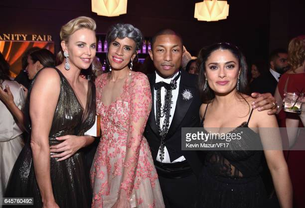 Actor Charlize Theron model Helen Lasichanh recording artist Pharrell Williams and actor Salma Hayek attend the 2017 Vanity Fair Oscar Party hosted...