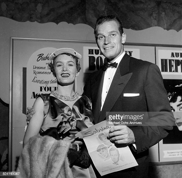 Actor Charlton Heston and his wife Lydia Clarke attend the movie premiere of 'Sabrina' in Los AngelesCA