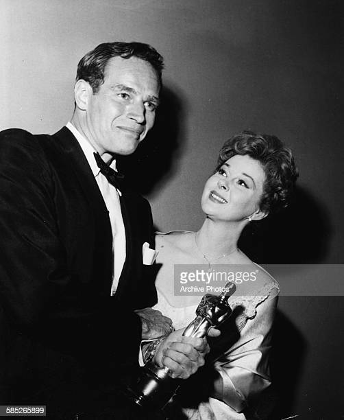 Actor Charlton Heston holding his Oscar for the film 'Ben Hur' with presenter Susan Hayward at the 32nd Academy Awards Los Angeles April 4th 1960