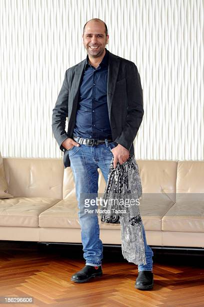 Actor Checco Zalone attends the 'Sole A Catinelle' photocall on October 30 2013 in Milan Italy