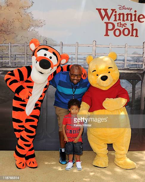 Actor Chi McBride and his son Myles pose at the premiere of Walt Disney Pictures' 'Winnie The Pooh' at the Walt Disney Studios on July 10 2011 in...