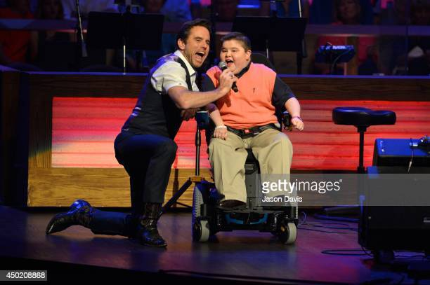Actor Chip Esten and former MDA Spokesman Bryson Foster announce musical guests at Grand Ole Opry House on June 6 2014 in Nashville Tennessee