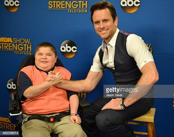 Actor Chip Esten and former MDA spokesman Bryson Foster arrive at Grand Ole Opry House on June 6 2014 in Nashville Tennessee