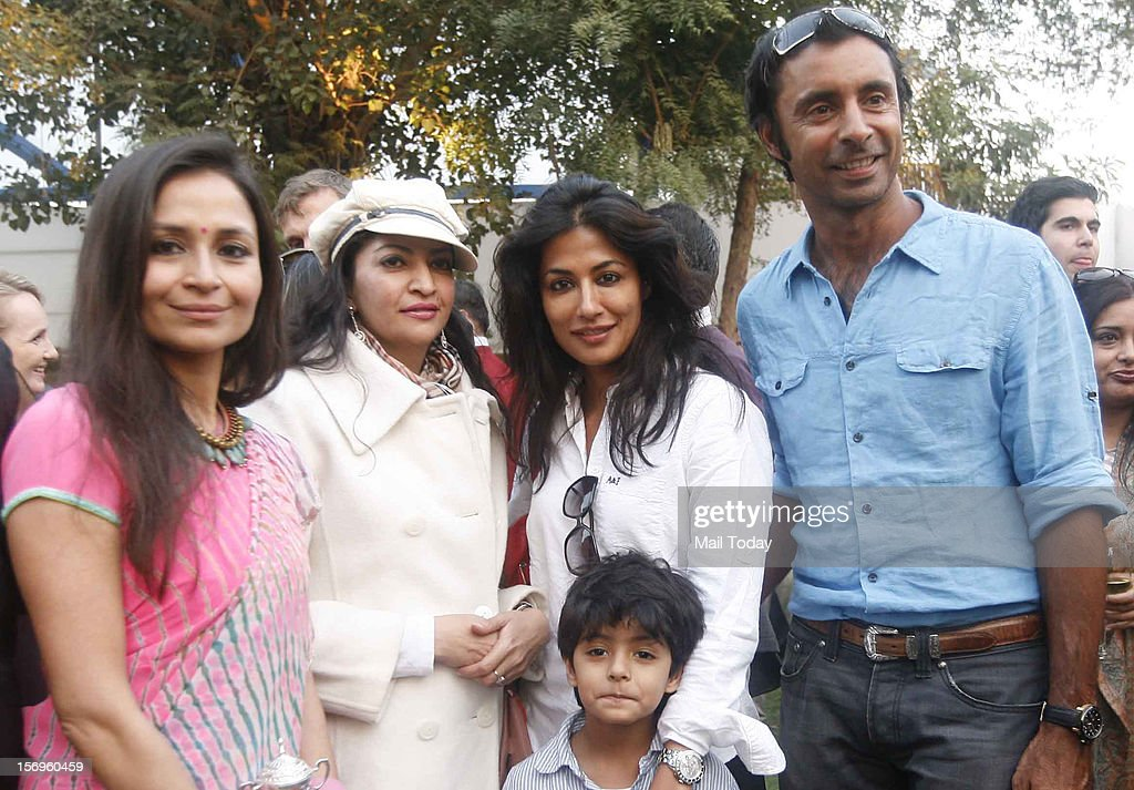 Actor Chitrangada Singh with husband Jyoti Randhawa and son Zorawar during Yes Bank India Masters Polo 2012 Trophy in New Delhi on Sunday.