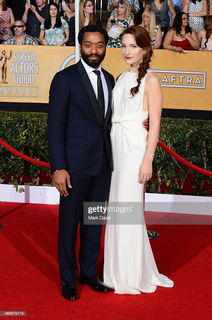 Actor <a gi-track='captionPersonalityLinkClicked' href=/galleries/search?phrase=Chiwetel+Ejiofor&family=editorial&specificpeople=213998 ng-click='$event.stopPropagation()'>Chiwetel Ejiofor</a> (L) and Sari Mercer attend 20th Annual Screen Actors Guild Awards at The Shrine Auditorium on January 18, 2014 in Los Angeles, California.