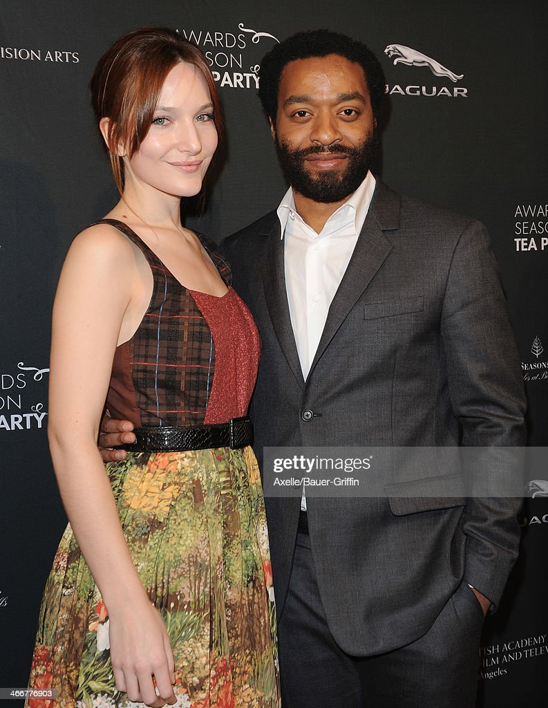 Actor <a gi-track='captionPersonalityLinkClicked' href=/galleries/search?phrase=Chiwetel+Ejiofor&family=editorial&specificpeople=213998 ng-click='$event.stopPropagation()'>Chiwetel Ejiofor</a> (R) and Sari Mercer attend the BAFTA LA 2014 Awards Season Tea Party at Four Seasons Hotel Los Angeles in Beverly Hills on January 11, 2014 in Beverly Hills, California.
