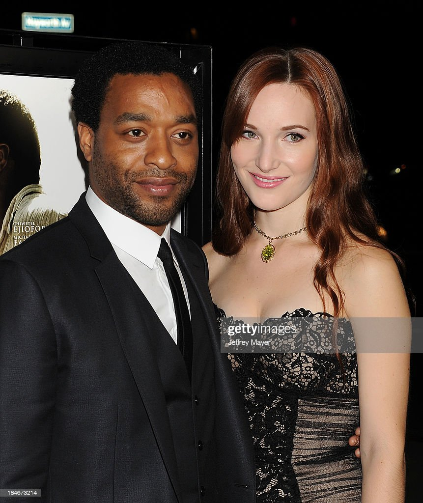Actor Chiwetel Ejiofor and Shari Mercer arrive at the Los Angeles premiere of '12 Years A Slave' at Directors Guild Of America on October 14, 2013 in Los Angeles, California.
