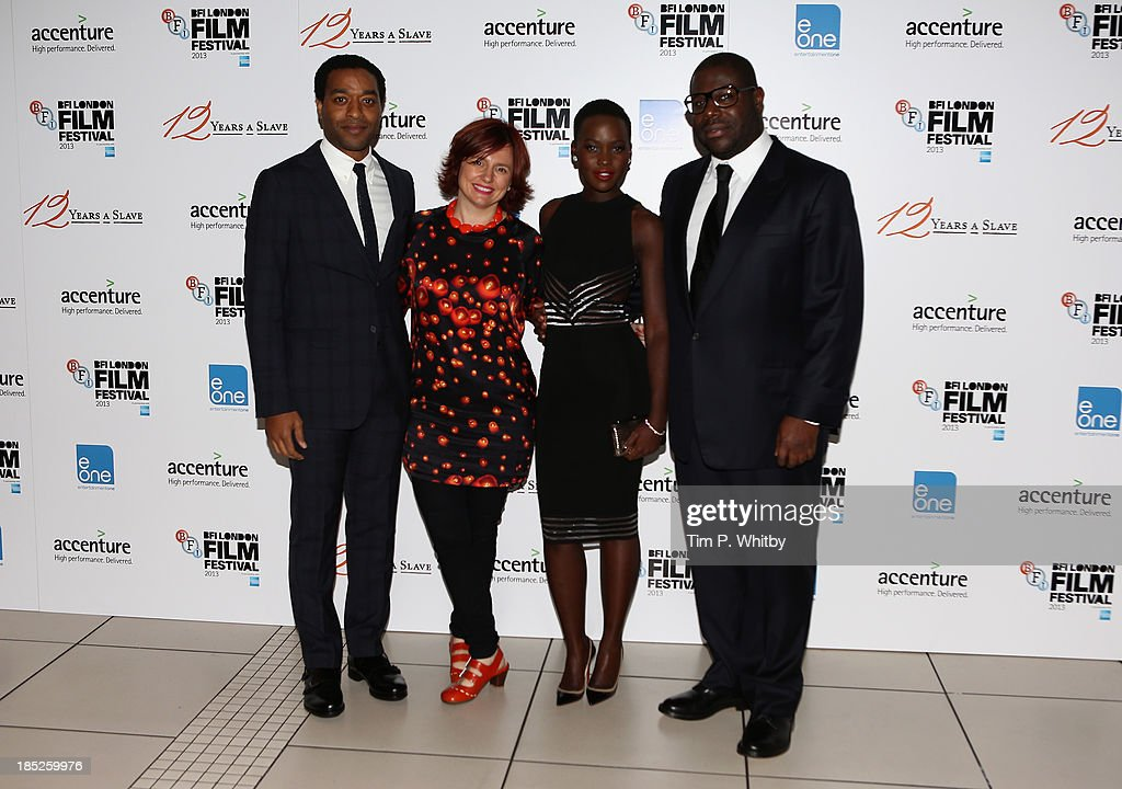 Actor <a gi-track='captionPersonalityLinkClicked' href=/galleries/search?phrase=Chiwetel+Ejiofor&family=editorial&specificpeople=213998 ng-click='$event.stopPropagation()'>Chiwetel Ejiofor</a>, Clare Stewart, actress <a gi-track='captionPersonalityLinkClicked' href=/galleries/search?phrase=Lupita+Nyong%27o&family=editorial&specificpeople=10961876 ng-click='$event.stopPropagation()'>Lupita Nyong'o</a> and director Steve McQueen attend the European Premiere of 'Twelve Years A Slave' during the 57th BFI London Film Festival at Odeon Leicester Square on October 18, 2013 in London, England.