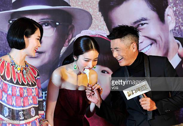 Actor Chow YunFat and Thailand shemale Poy attend press conference of movie 'The Man From Macau II' on February 11 2015 in Chengdu Sichuan province...