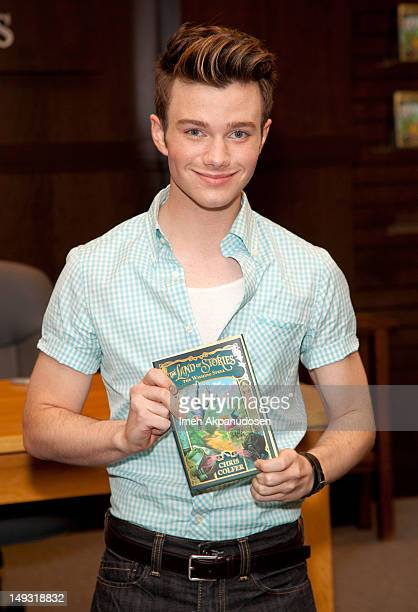 Actor Chris Colfer poses before signing copies of his new book 'The Land Of Stories The Wishing Spell' at Barnes Noble bookstore at The Grove on July...