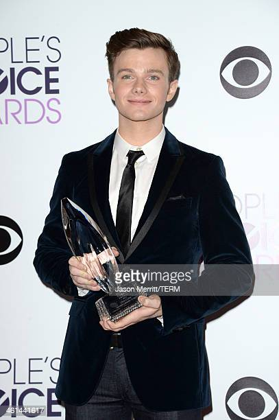 Actor Chris Colfer winner of the Favorite Comedic TV Actor award for 'Glee' poses in the press room at The 40th Annual People's Choice Awards at...