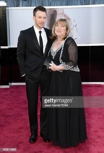 Actor Chris Evans and mother Lisa Evans arrive at the Oscars at Hollywood Highland Center on February 24 2013 in Hollywood California