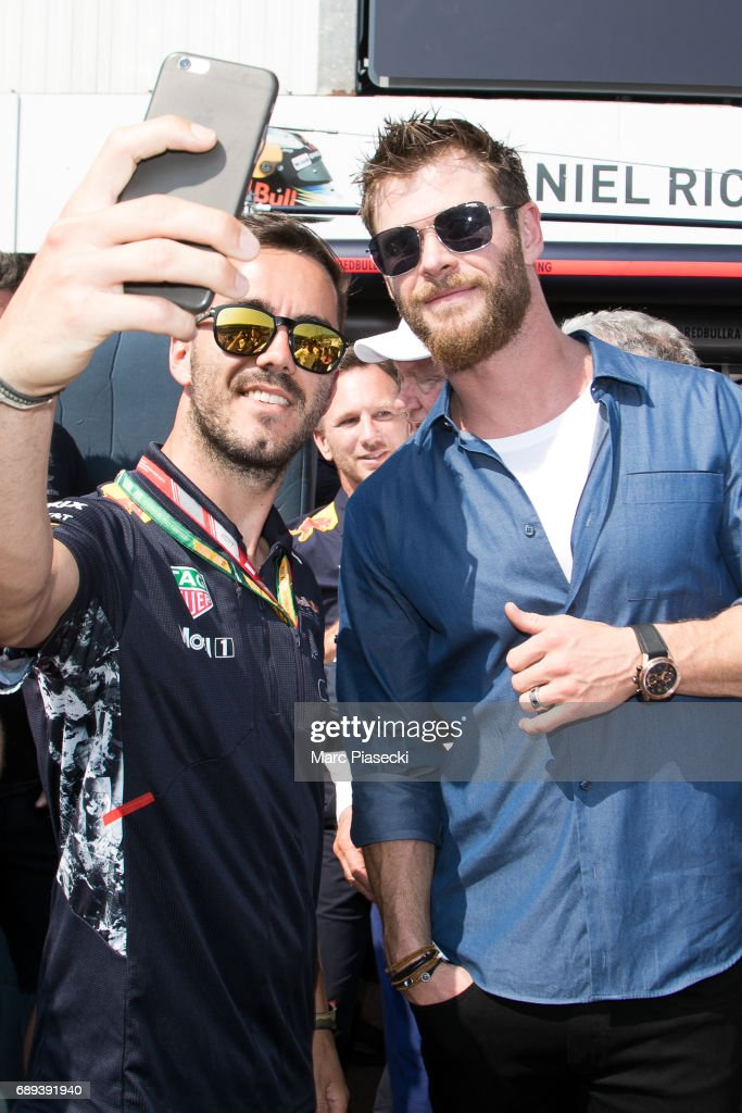 Actor Chris Hemsworth (R) poses for a selfie as he attends the Monaco Formula 1 Grand Prix at the Monaco street circuit, on May 28, 2017 in Monaco.