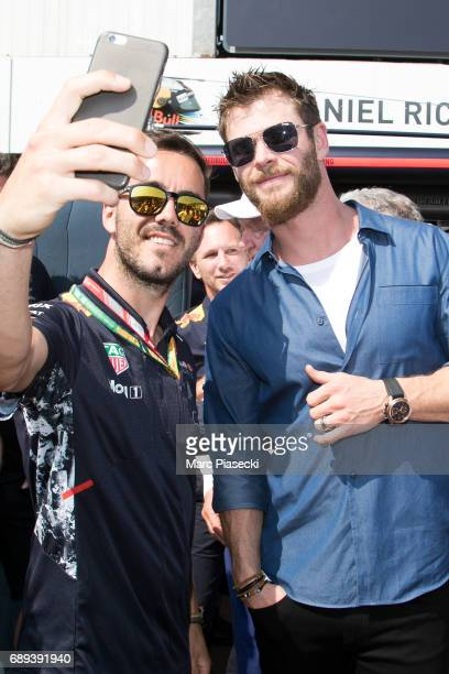 Actor Chris Hemsworth poses for a selfie as he attends the Monaco Formula 1 Grand Prix at the Monaco street circuit on May 28 2017 in Monaco