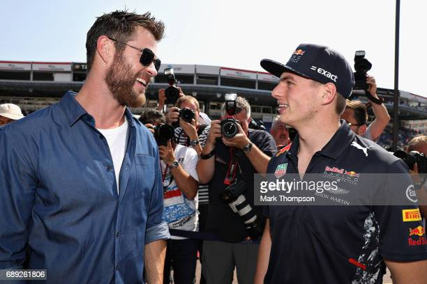 Actor Chris Hemsworth talks with Max Verstappen of Netherlands and Red Bull Racing during the Monaco Formula One Grand Prix at Circuit de Monaco on...