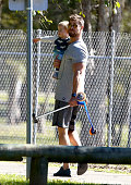 Actor Chris Hemsworth with one of his children at Broadbeach Waters Park on the Gold Coast Queensland