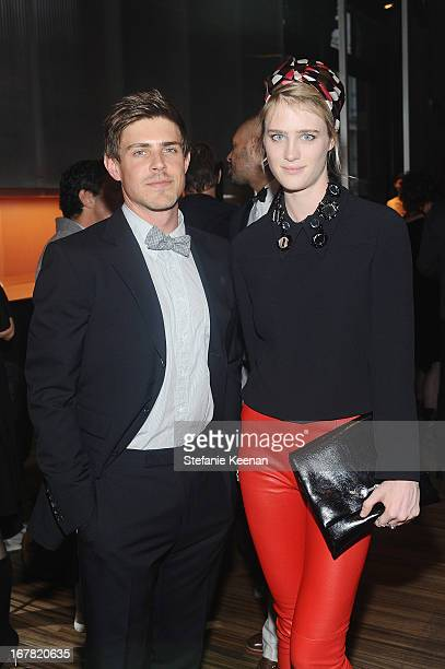 Actor Chris Lowell and actress Mackenzie Davis wearing Miu Miu attend Catherine Martin And Miuccia Prada Dress Gatsby Opening Cocktail on April 30...